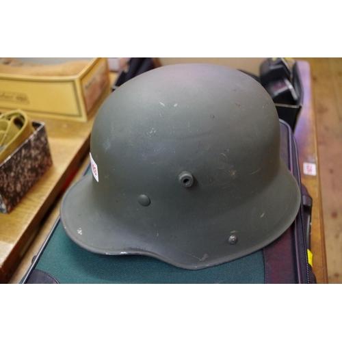 1693 - <strong>A World War I German Transitional helmet.</strong>...