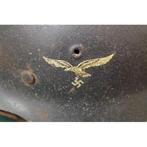 1694 - <strong>A German World War II helmet,</strong>withLuftwaffe transfer....