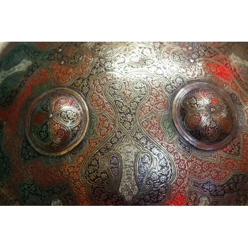 1696 - <strong>An Ottoman</strong><strong>brass and inlaid shield,</strong> with coloured decoration, 33cm...