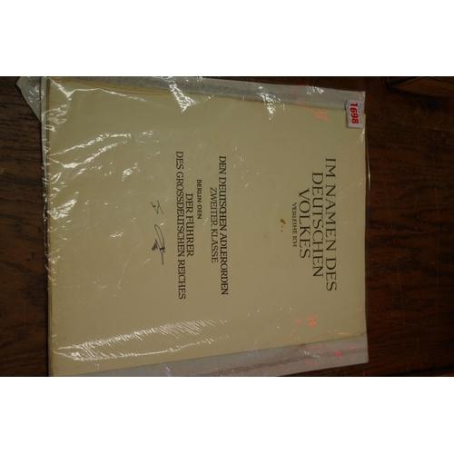 1698 - <strong>A World War IIEagle Order 5th class citation, </strong>in original folder....