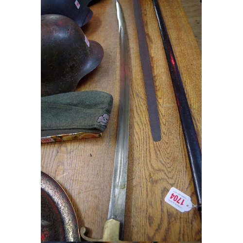 1702 - <strong>An antique cavalry sabre,</strong>with 85cm fullered blade, and having brass guard, in...