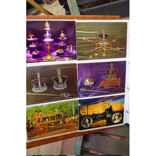 1706 - <strong>Postcards:</strong>an album containing Elizabeth II commemorative examples; and others....