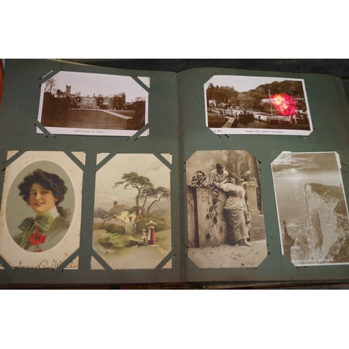 1707 - <strong>An old album of photographs and postcards. </strong>...