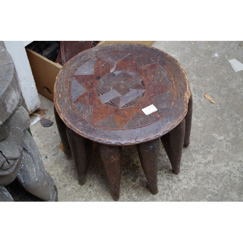 1050A - <strong>Ethnographica</strong>: two tribal figural stools, largest 51cm high; together with another ...
