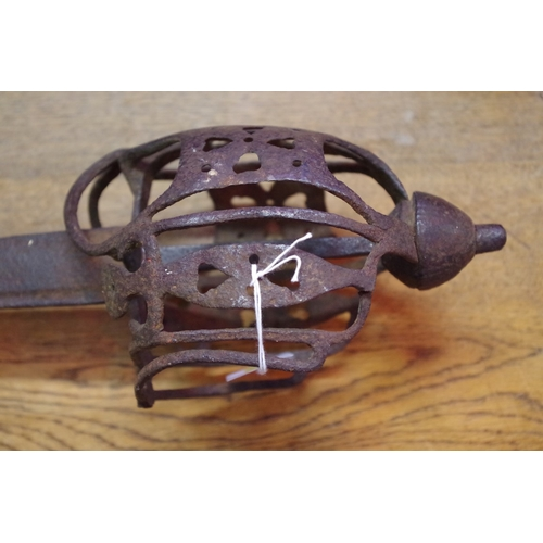 1701 - <strong>A late 17th/early 18th century Scottish basket hilt sword,</strong>with 81.5cm blade....