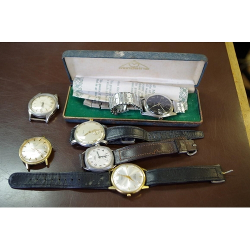 186 - <strong>A quantity of vintage gentlemans wristwatches;</strong> to include a Mondaine; a Rone; a Tis...