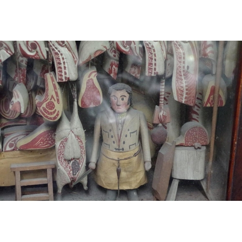 1379 - <strong>A 19th century carved and painted wood butcher's shop diorama, </strong>the visible area 40 ...
