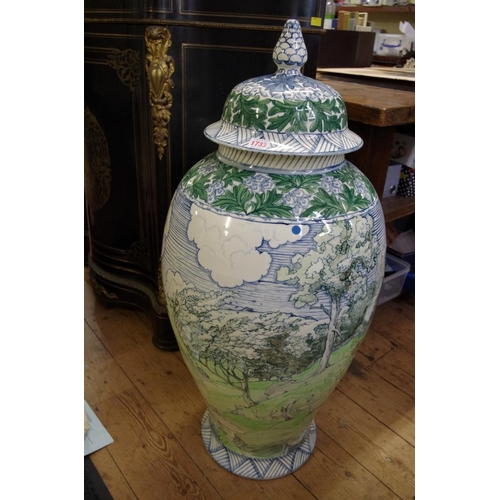 1733 - <strong>A very large Dutch polychrome painted vase and cover, </strong>91.5cm high....