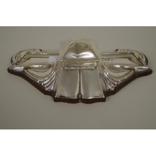 21 - <strong>An Art Nouveau silver inkstand,</strong> <em>by William Neale</em>, Birmingham 1911, mounted...