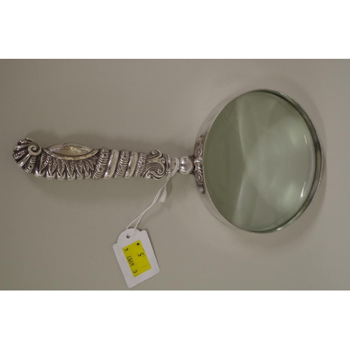 24 - <strong>A large magnifying glass in unmarked mount,</strong> 27cm overall length....