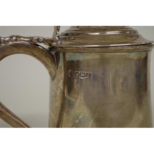 30 - <strong>A silver dome lidded tankard,</strong> <em>by Thomas Bradbury & Sons,</em> Sheffield 192...