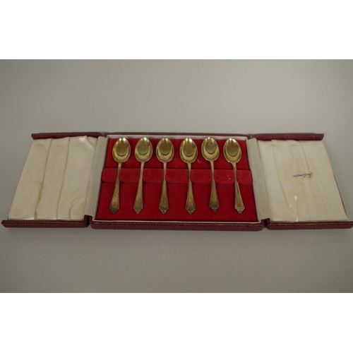 41 - <strong>A cased set of six silver gilt coffee spoons,</strong><em>by</em> <em>Turner & Simpson ...