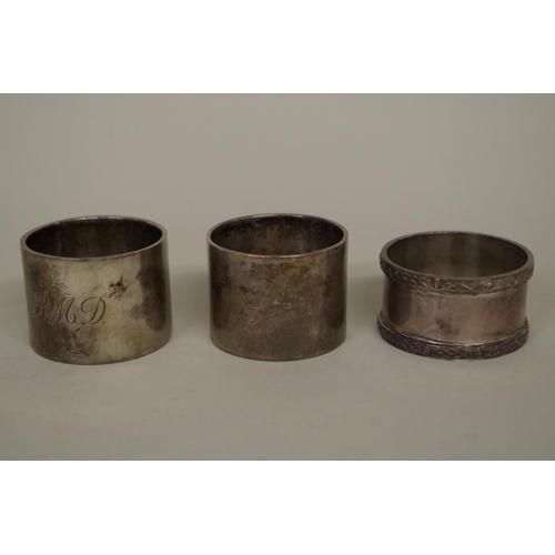 46 - <strong>Three various silver napkin rings,</strong> 171g...