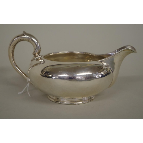 9 - <strong>A Victorian silver milk jug,</strong> <em>by George Ivory, </em>London 1846, 17cm ...