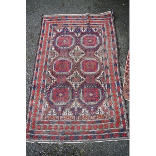 1100 - <strong>A Persian rug,</strong>having repeated geometric design to central field and border; t...
