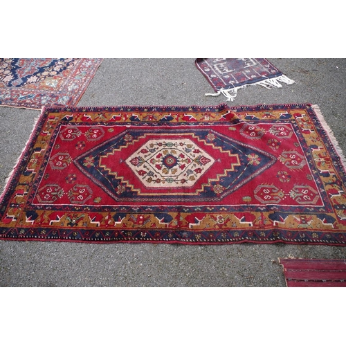 1101 - <strong>A Persian rug,</strong>having central floral and geometric medallion, with allover floral a...