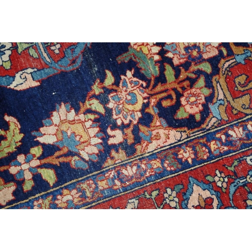 1104 - <strong>A Tabriz rug,</strong>having central floral medallion on a red ground with floral decoratio...