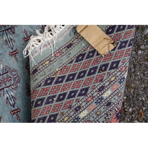 1105 - <strong>A Persian rug,</strong>having repeated design to central field with allover geometric decor...