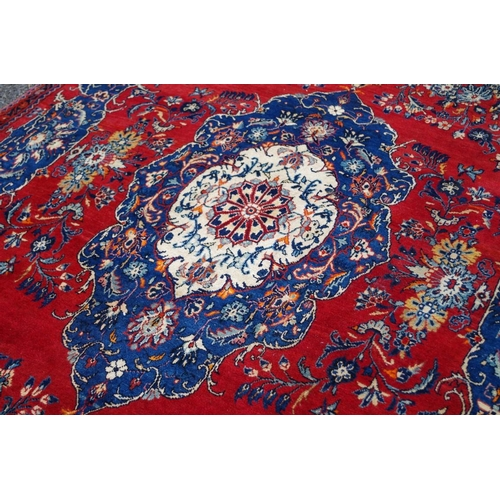 1106 - <strong>A Persian carpet,</strong>having floral central medallion with allover floral design with a...