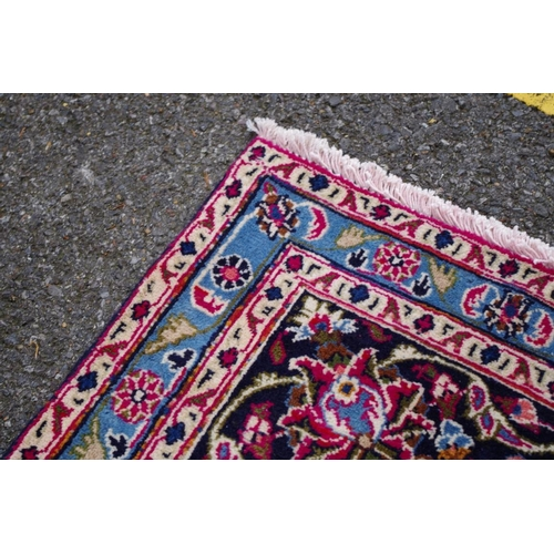 1107 - <strong>A Persian style carpet, </strong>having central floral medallion with allover floral design ...
