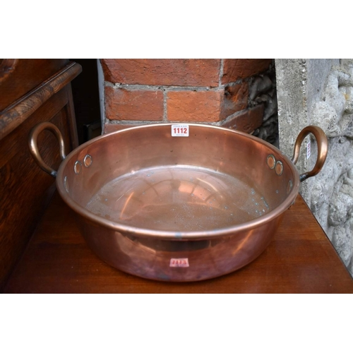 1112 - <strong>A copper twin handled preserving pan,</strong>32cm diameter....