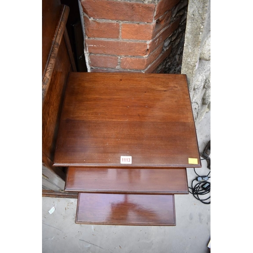 1113 - <strong>A nest of three mahogany tables, </strong>largest 43cm wide....