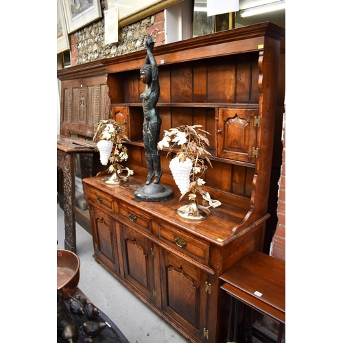 1115 - <strong>A reproduction oak panelled</strong><strong>dresser and rack,</strong> 156cm wide....