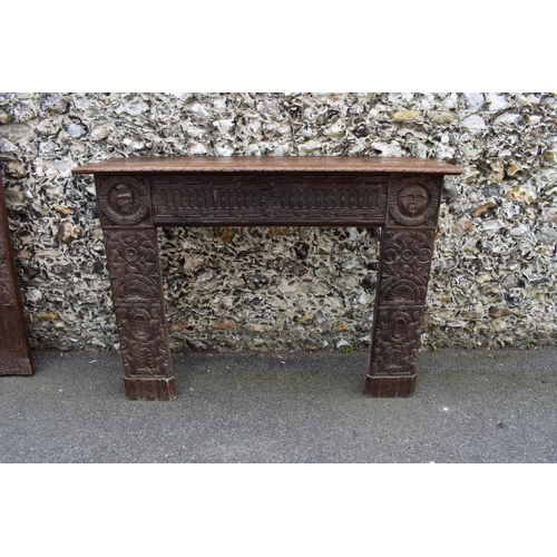 1118 - <strong>An interesting French carved oak fire surround, </strong>containing 16th/17th century elemen...