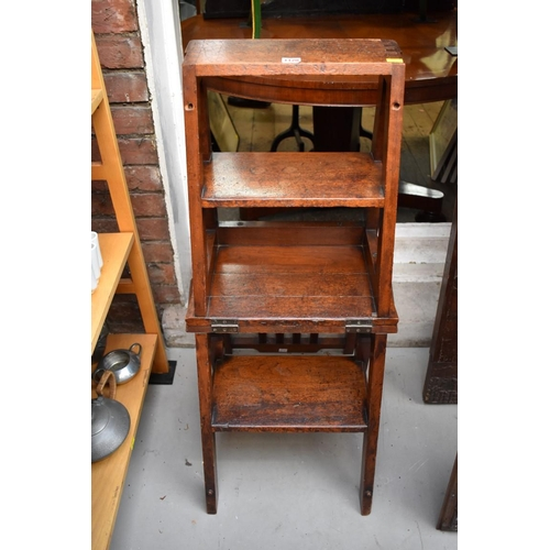 1120 - <strong>A set of late 19th/early 20th century walnut metamorphic library steps.</strong>...