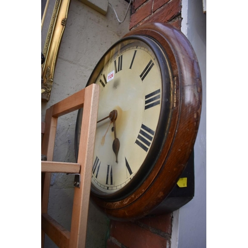 1124 - <strong>A beechwood circular wall clock, </strong>with 14in dial, with pendulum.  ...