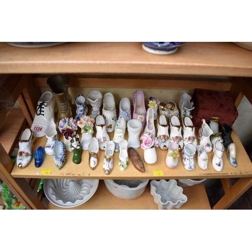 1128 - <strong>A collection of ceramic shoe models;</strong> and other similar. ...