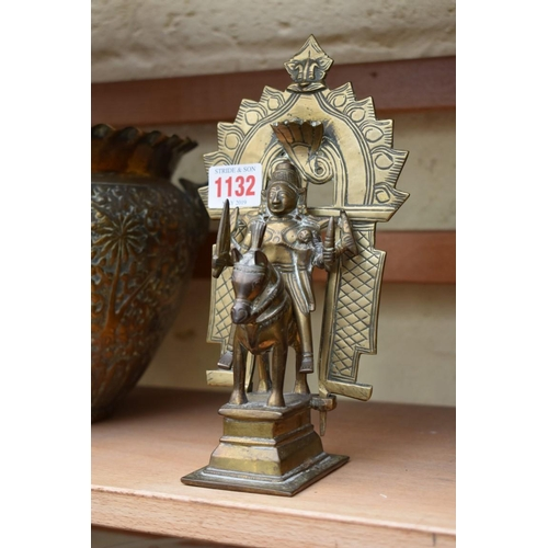 1132 - <strong>An Indian brass figure of a Deity on horse,</strong> 21cm high; together with a pair of Indi...