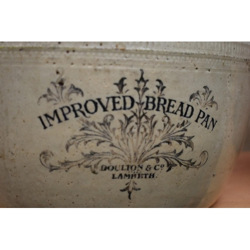 1138 - <strong>A Doulton Lambeth 'Improved Bread Pan'; </strong>and another earthenware jug....