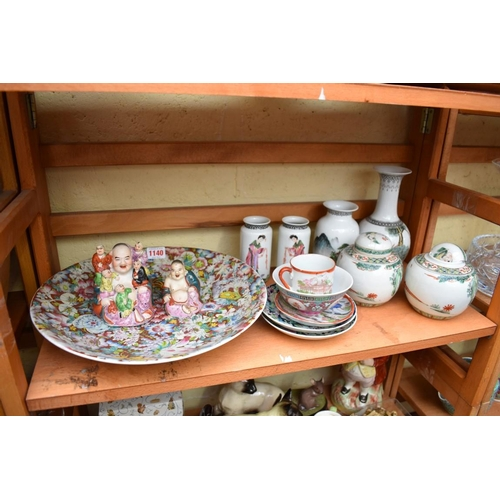 1140 - <strong>A small collection of Chinese porcelain,</strong>to include a famille rose figure group of ...