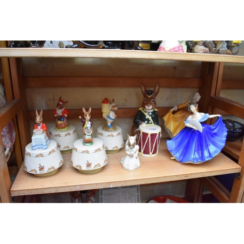 1142 - <strong>A small collection of Royal Doulton figures,</strong>to include Bunnykins musical exam...