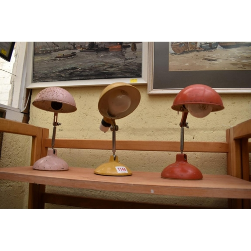 1144 - <strong>Three vintage painted metal articulated desk lamps. </strong>...