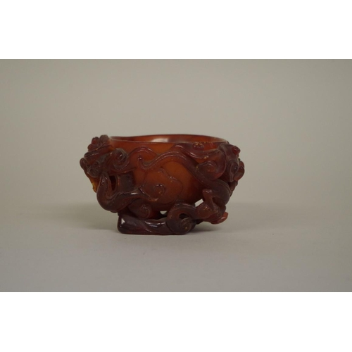 732 - <strong>A very rare Chinese carved amber libation cup, </strong><em>17th century, </em>carved in hig...