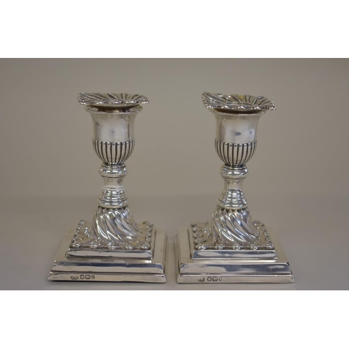 1 - <strong>A pair of Victorian silver squat candlesticks, </strong><em>by John Round &amp; Son Ltd, </e...