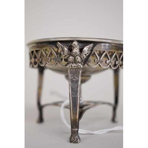12 - <strong>A Continental white metal salt,</strong> decorated eagles and having gilt interior, 6cm high...