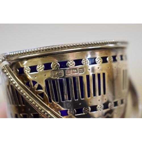 14 - <strong>A pierced silver sugar basket,</strong><em>by L &amp; W,</em> Birmingham 1911, 11cm high, 9...