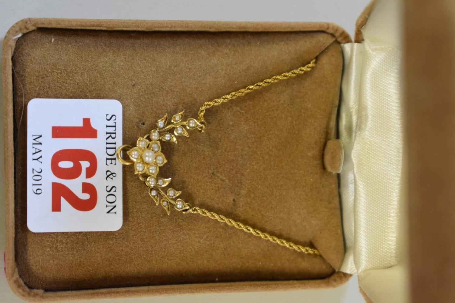 An unmarked yellow metal pearl 'floral garland' necklace.
