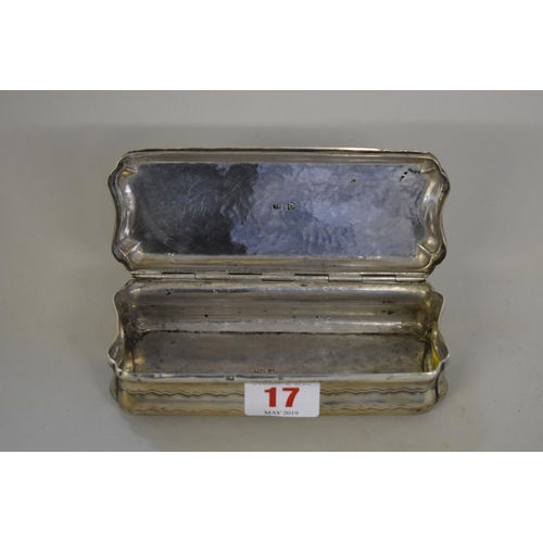 17 - <strong>A Dutch white metal tobacco box</strong>, having pastoral scenes to both sides, 14cm wide....