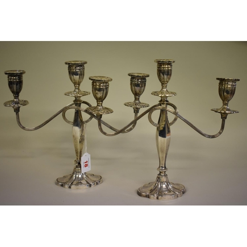 18 - <strong>A pair of silver twin branch candelabra,</strong> <em>by Alexander Smith, </em>Birmingham 19...