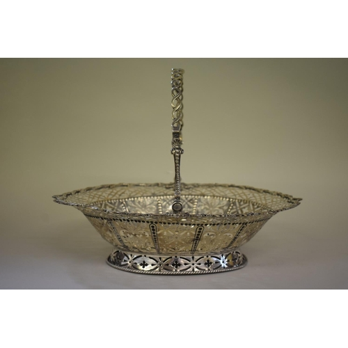 22 - <strong>A George lll pierced silver bread basket, </strong><em>by William Plummer,</em> London 1766,...