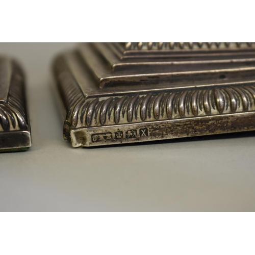 23 - <strong>A pair of Victorian silver Corinthian column candlesticks,</strong><em>by</em><em>Hawkswor...