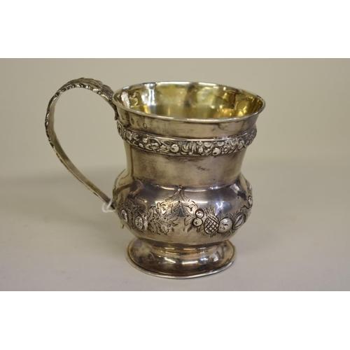27 - <strong>A Georgian silver waisted mug,</strong> <em>marks rubbed</em>, London, 9cm, 145g....