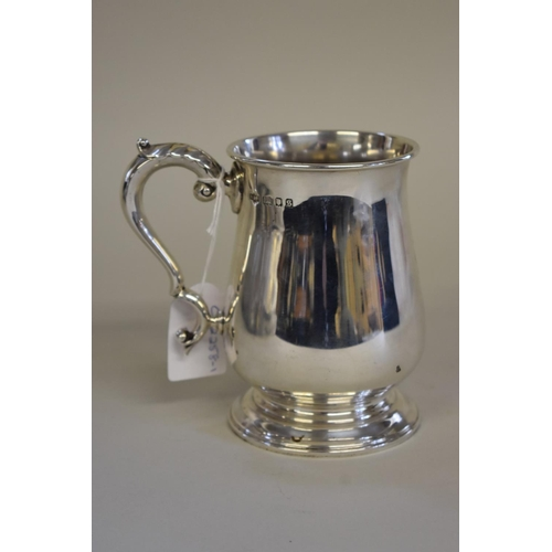 28 - <strong>A silver baluster tankard,</strong> <em>by Alstons &amp; Hallam,</em> London 1933, 12.5cm hi...