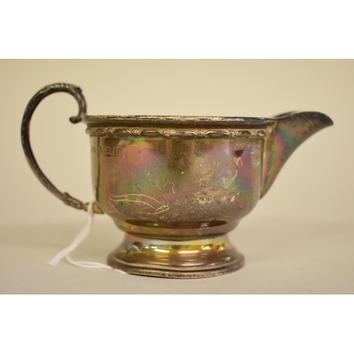 29 - <strong>A silver cream jug,</strong><em>by Aaron Lufkin & Dennison</em>, Birmingham 1939, ...