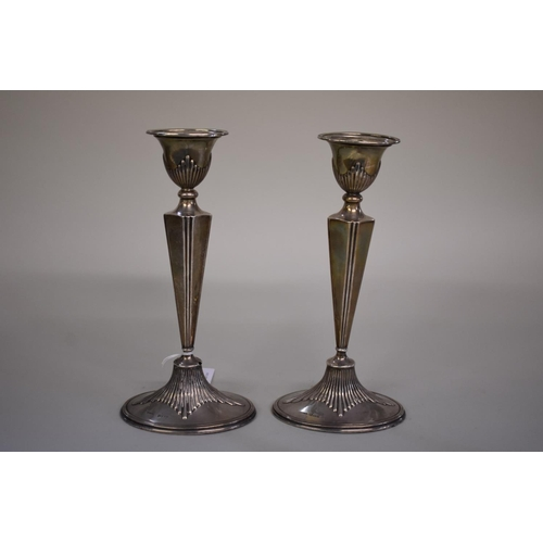31 - <strong>A pair of silver candlesticks,</strong><em>by Cornelius Desormeaux Saunders &amp; James Fra...