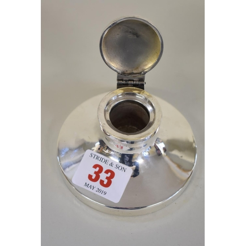 33 - <strong>A silver capstan inkwell</strong>, <em>by</em><em>Sanders & Mackenzie</em>, Birmin...